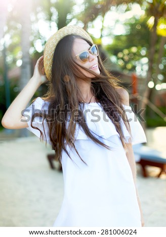 Woman in bikini on a tropical beach at Thailand.Close up fashion portrait of stylish young woman wear summer bright dress,look retro,sunglasses and hat,perfect skin and amazing long brunette hairs. - stock photo