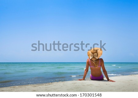 woman in bikini on the beach - stock photo