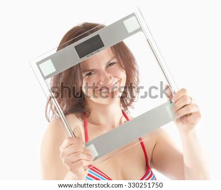 Woman in Bikini Swimwear Holding Scale - stock photo