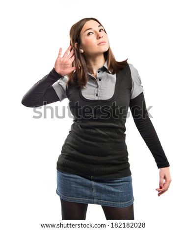 Woman in black clothes listening over white background  - stock photo