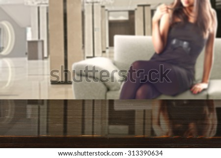 woman in black dress and sofa in room with glasses black space