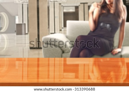 woman in black dress and sofa in room with wooden glasses space and free place for you