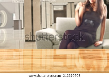 woman in black dress and sofa in room with yellow wooden desk space and space for you