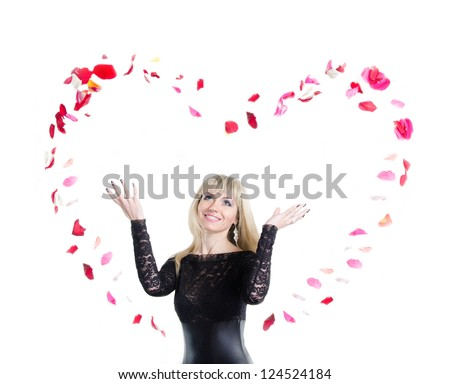 Woman in black dress and the heart from rose petals. Isolated on white background