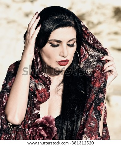 Woman in black dress.Portrait of Flamenco dancer in yellow rock background. Photo of flamenco dancer. Beautiful brunette woman, flamenco dancer in natural background. Sadness - stock photo