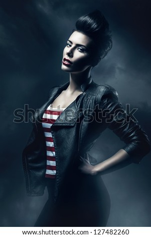 woman in black jacket in the fog - stock photo