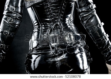 woman in black latex uniform, corset, back