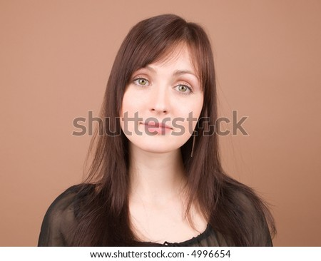 Woman in black portrait isolated on beige background - stock photo