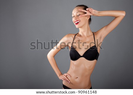 woman in black sexy lingerie on a gray - stock photo