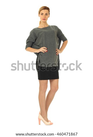 Woman in black skirt standing in full length
