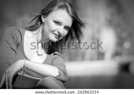 Woman in Black & White in nature - stock photo