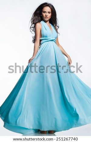 woman in blue dress on white background - stock photo