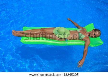 Woman in blue pool in Greece - stock photo