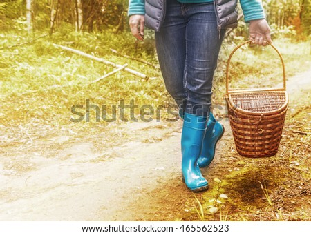 Woman in boots with a basket.