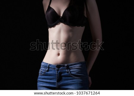 Woman in bra and jeans