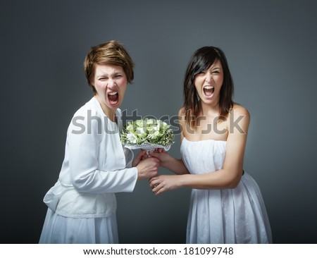 woman in bride dress fighting - stock photo