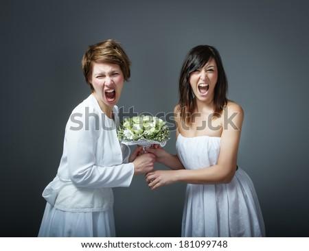 woman in bride dress fighting - stock photo