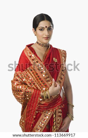 Woman in bright red mekhla