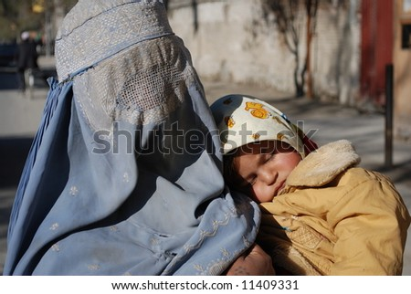 Woman in burka with child