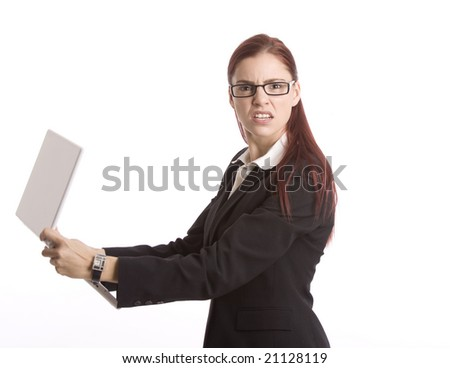 Woman in business attire angrily holding laptop computer