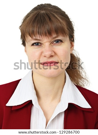 Woman in business suit pulls a face in upset grimace isolated on white background