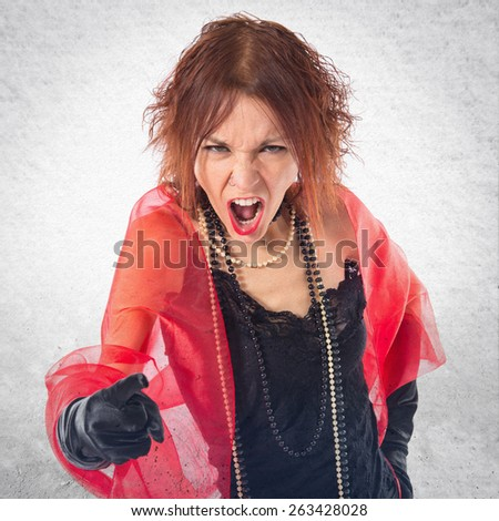 Woman in cabaret style shouting over textured background