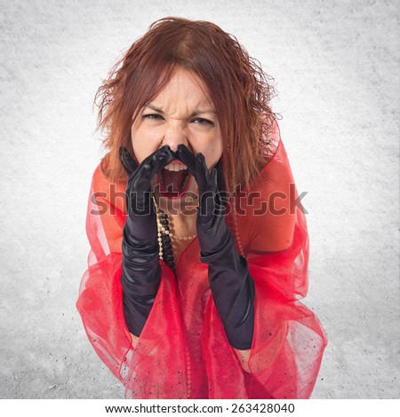 Woman in cabaret style shouting over textured background   - stock photo