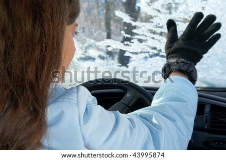 woman in car in winter - stock photo