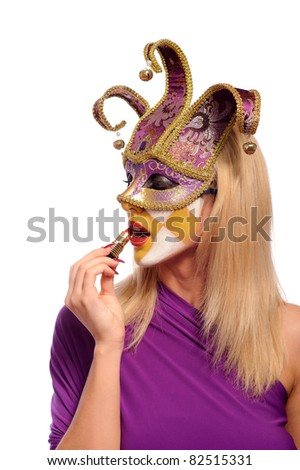 Woman in carnival dress and venetian party mask, doing make-up, isolated on white