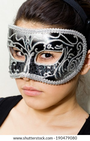 Woman in carnival mask - stock photo