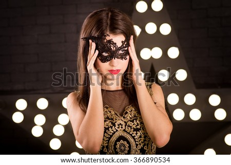 Woman in carnival masquerade mask. Party - stock photo