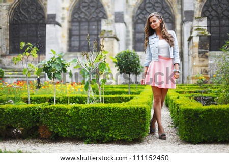 woman in cathedral park - stock photo