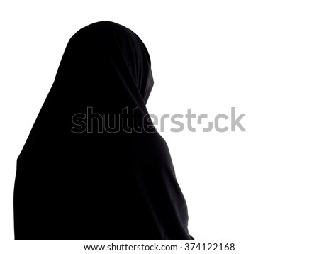 Woman in chador from behind, with copyspace. Dark image, ideal to add text etc. - stock photo