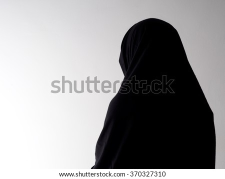 Woman in chador from behind, with copyspace. Unidentifiable. - stock photo