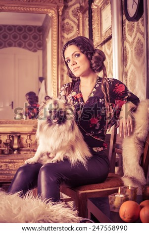 Woman in classic interior with pomeranian. VIntage/Retro