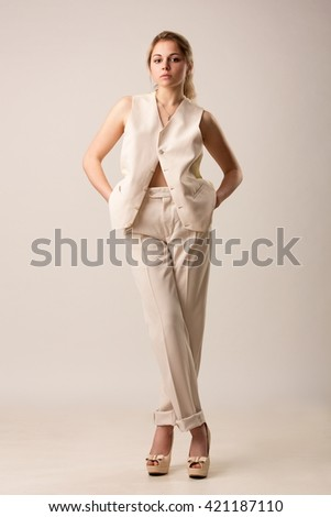 Woman in classic white vest isolated on white