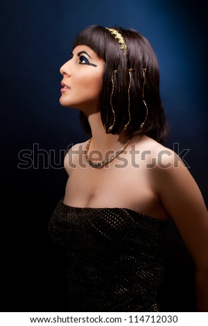 Woman in Cleopatra style with ancient egyptian make up - stock photo
