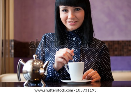 woman in coffee with cup and teapot