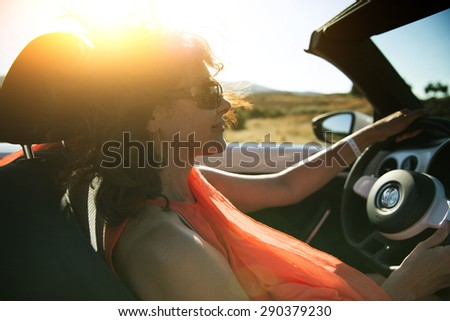 Woman in convertible touring night