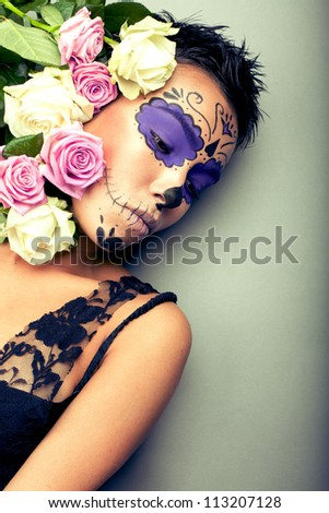 woman in day of the dead mask portrait - stock photo