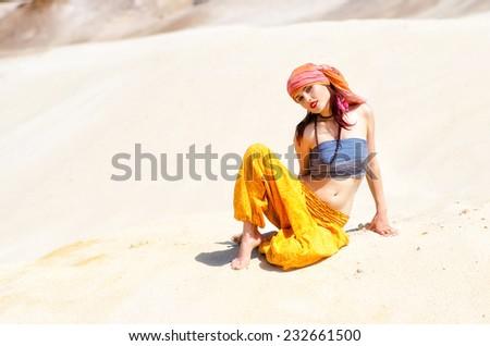 Woman in desert - stock photo