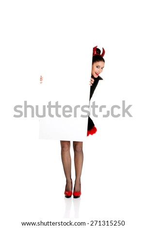 Woman in devil carnival costume with empty banner. - stock photo