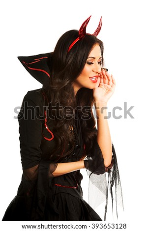Woman in devil clothes whispering to someone