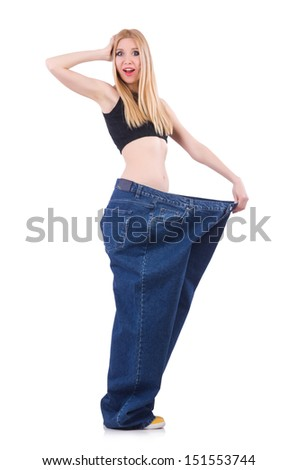 Woman in dieting concept with big jeans - stock photo
