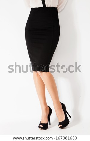 woman in elegant tight black skirt and high heel shoes - stock photo