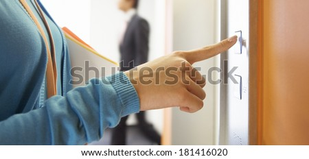 Woman in elevator or lift - stock photo