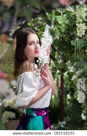 Woman in fairy floral garden