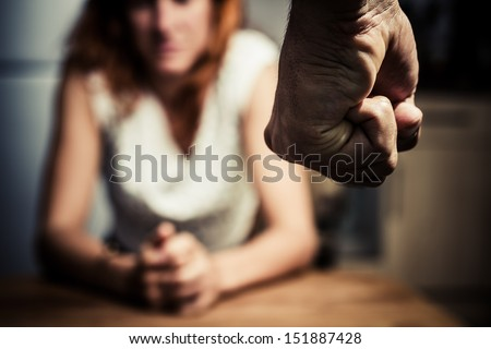 Woman in fear of domestic abuse - stock photo