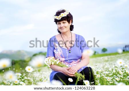 woman in field - stock photo