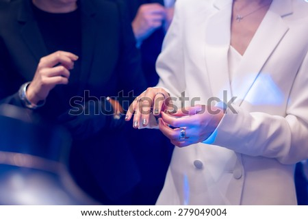 Woman In Fine luxury jewellery boutique try a new ring on her finger - stock photo